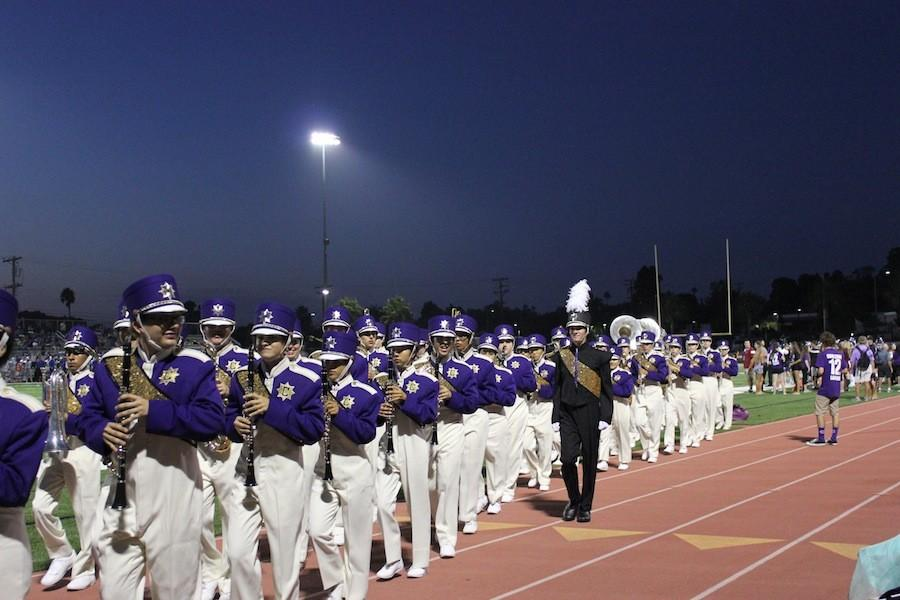 The band team shows that practice really does make perfect as they exit the field leaving the crowd in awe.