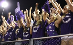 Loud crowd bleeds purple pride