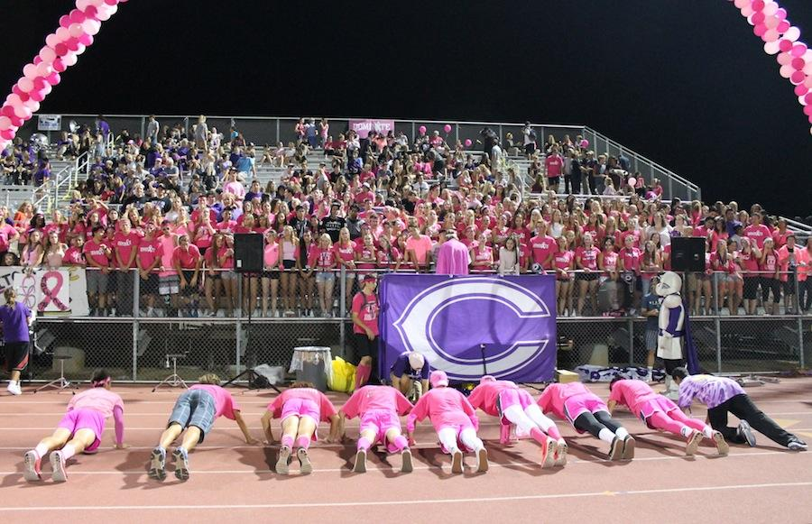 Loud Crowd does push-ups after every touchdown. They helped everyone get into the spirit of the game.