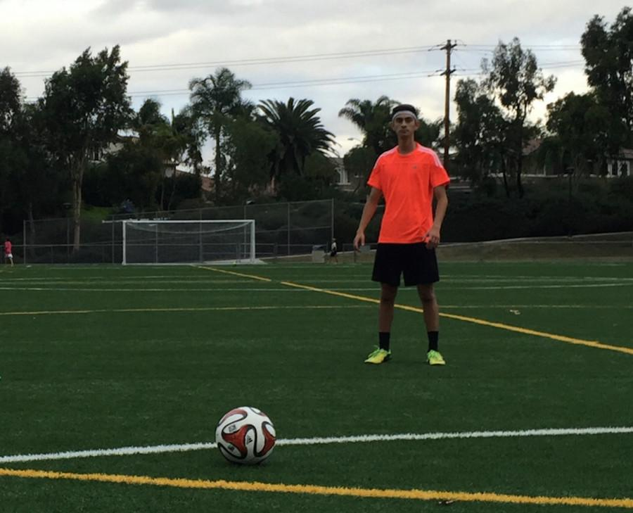 Senior Badr Suleiman prepares to kick the soccer ball. Lately, soccer has been becoming increasingly popular in the United States.