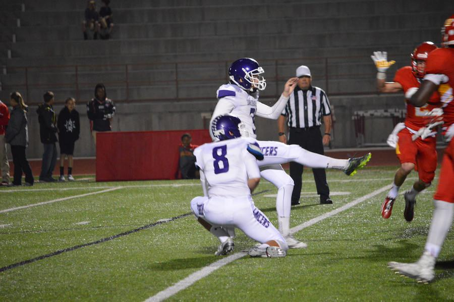 Senior Collin Riccitelli kicks a field goal during the Carlsbad vs. Cathedral CIF playoff game on November 20. The final score was 24-21 Cathedral, ending the Lancer's 2015 football season.