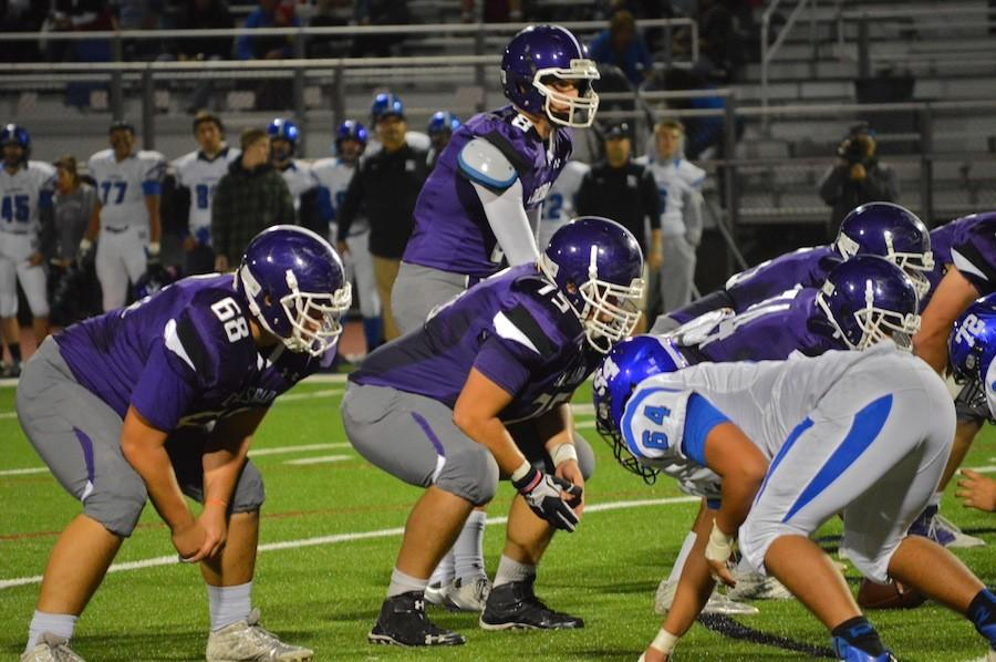 Senior+QB%2C+Shea+Morales+waits+to+receive+the+snap%2C+hoping+to+add+to+Carlsbad%27s+leading+score.+The+win+against+Ramona+allows+the+Lancer%27s+to+come+back+for+another+game+against+Cathedral+Catholic+High+School+on+November+20.