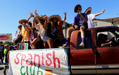 The Spanish Club rides on their float in the Lancer Day parade.  Spanish Club meets the first even Monday of each month in room 5004.