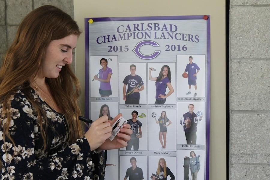 Champion+Lancer%2C+Megan+Schoen%2812%29+signs+a+trading+card+to+hand+out+to+elementary+and+middle+school+kids+encouraging++a+substance+free+life.+Multiple+times+a+month+the+Champion+Lancers+visit+elementary+and+middle+schools+and+participate+in+various+activities.