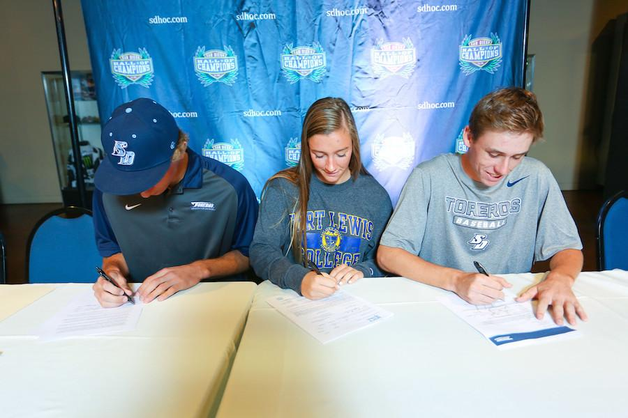 Seniors%2C+Nathan+Walker%2C+Delaney+Benson%2C+and+Trevor+Rosenberg+sign+their+National+Letters+of+Intent+on+Wednesday%2C+Nov.+11%2C+Veterans+Day.+They+are+officially+committing+to+their+college+of+choice+for+sports.+%28Photo+courtesy+of+Picture+Bakery%29