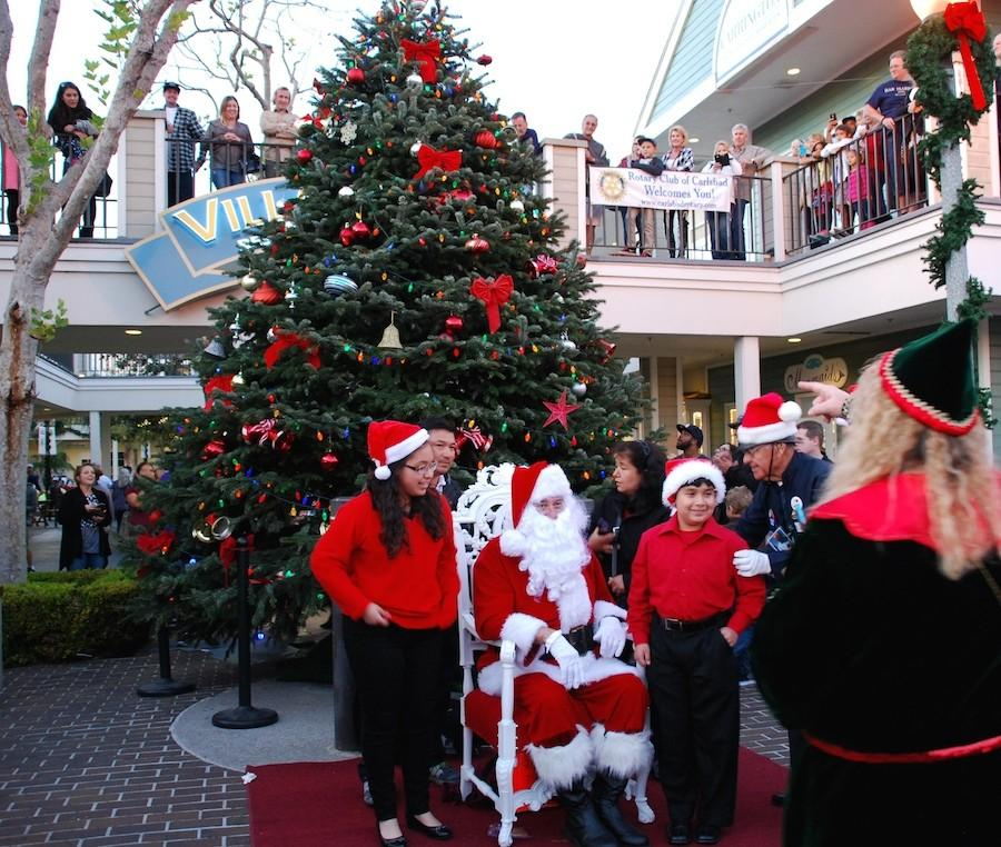 The+Carlsbad+holiday+tree+was+lit+by+Mayor+Matt+Hall+on+Sunday.+Santa+sat+in+front+of+the+tree+for+free+photos+for+the+public.