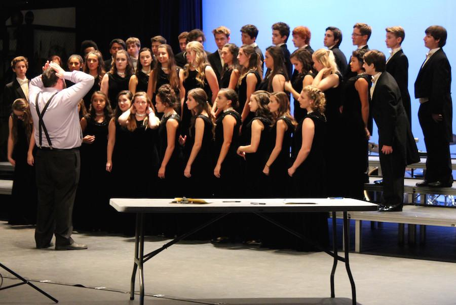 Members of choir get dressed up for photos and rehearsal. The CHS Choral Performance is taking place Dec. 3 to Dec. 5.
