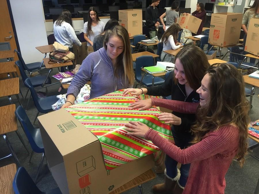 Mitchell Thorp Club 's Christmas toy fundraiser started last week throughout Carlsbad High School.  Members of the club designed and placed these boxes in every English class.