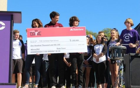Seniors, Sydney Payne, Joey Szalkiewicz, and Nick Lamarca created the video that won the Celebrate My Drive contest. They accepted the check from the State Farm associates on Tuesday, December 8.
