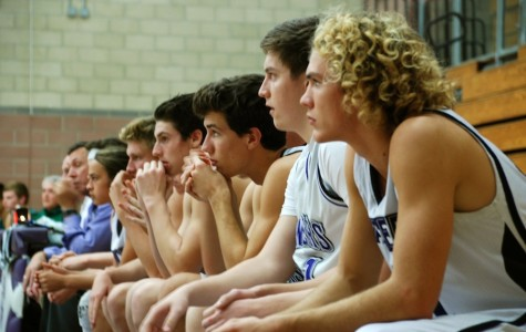 Members of the Carlsbad basketball team watch Wednesday's tough loss against Poway. The Lancers bounced back on Friday after winning the 'White Out' game against Orange Glen.