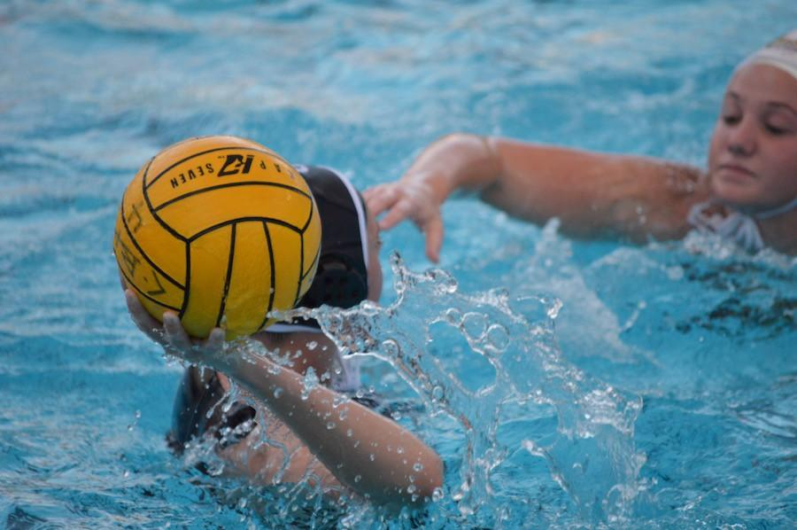#6 Jessie Smith (12) passes the ball over the head of a defender, seeking to assist another Carlsbad goal. On Thursday, Jan. 7 Carlsbad Highs girls varsity water polo team took on the El Camino Wildcats. The final score was 19-3 Lancers.