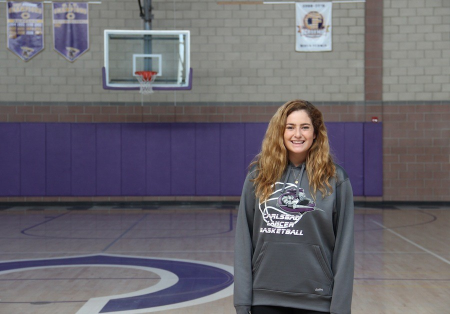 Junior Sarah Schneider plays post on the girls varsity basketball team. She has been playing basketball since she was four years old and is one of the team captains on the team this year.
