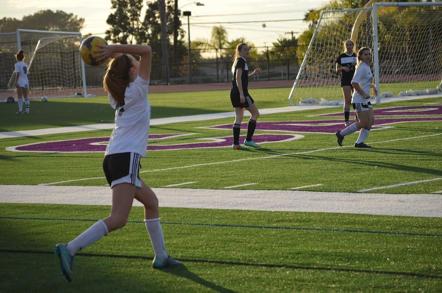 Sophomore Peyton Headlee throws in the ball in from the sideline to a teammate. On Wed. Jan. 27 Carlsbads Junior Varsity soccer team took on Sage Creek at home. The final score was 4-0 Lancers.