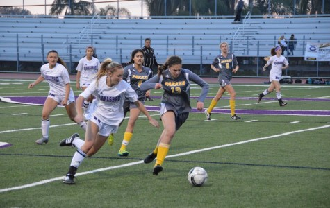 Freshman, Avery Shaffer, takes the ball towards the goal in their game against Parker High School on  Tues. Feb. 23. Lancers got the win, the score coming to 4-0.
