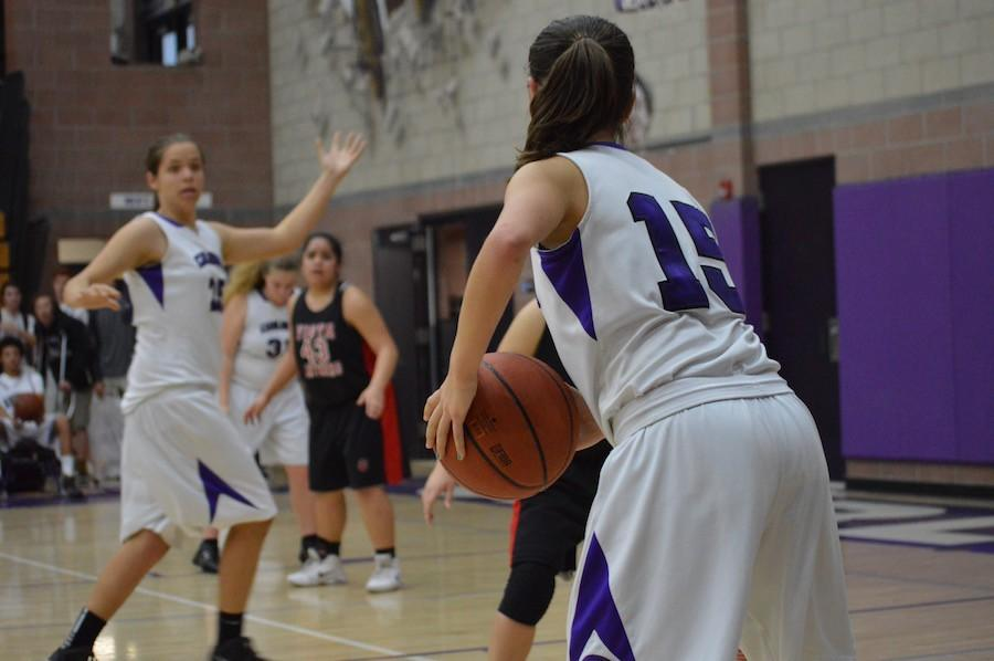 #15, Justine Bailey(11) passes the ball in from the sideline at JV girls basketball game against Vista on Friday, Feb. 5. The Lancers came out on top, winning 46-39.