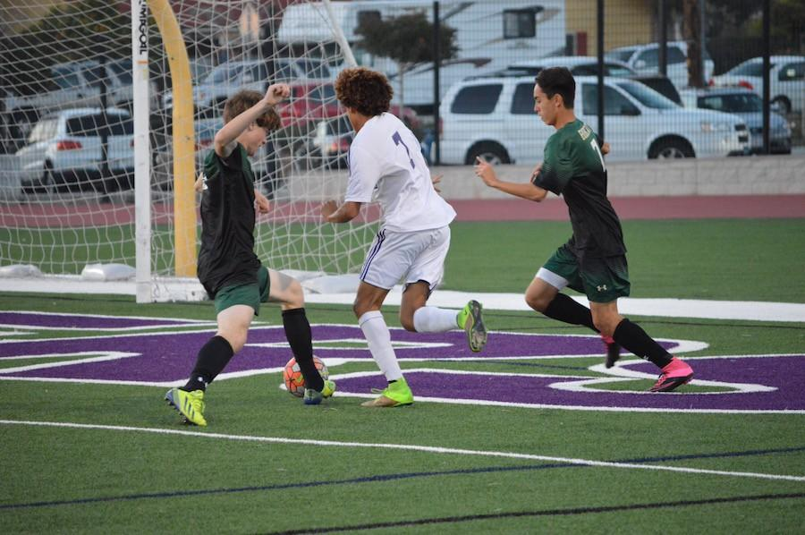 Junior, Lawrence Kyle fights past two Bobcat defenders, hoping to add another point to the scoreboard. Friday, Feb. 12 Carlsbad High Schools boys soccer went head to head against Sage Creek for their senior night. The ending score was a 2-0 Lancer win.