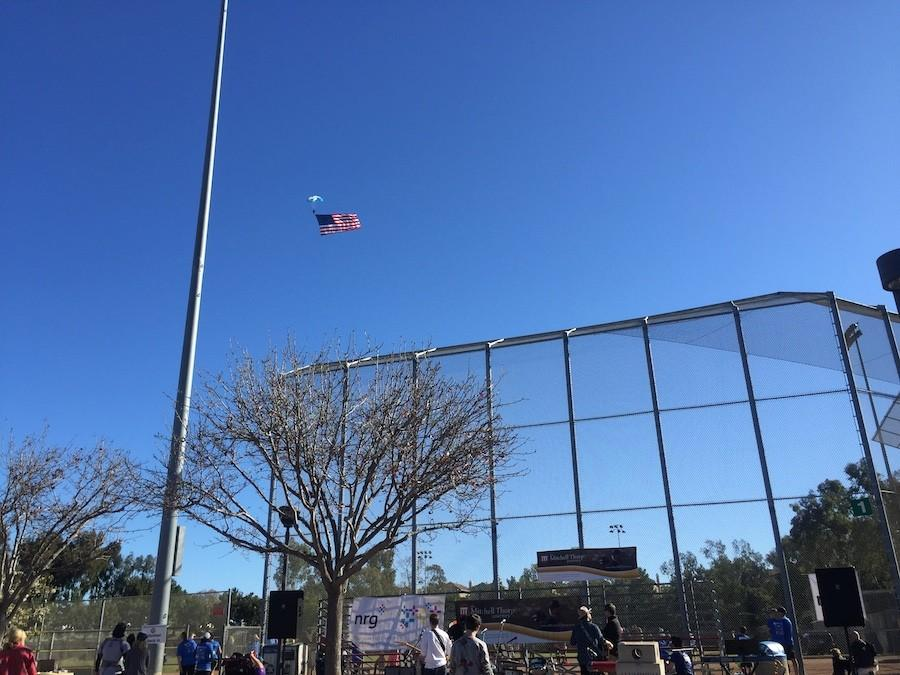Last Saturday, the Mitchell Thorp Foundation Run took place at poinsettia Park. Runners were entertained with Sky Divers who jumped out of a plain carrying a massive American Flag.