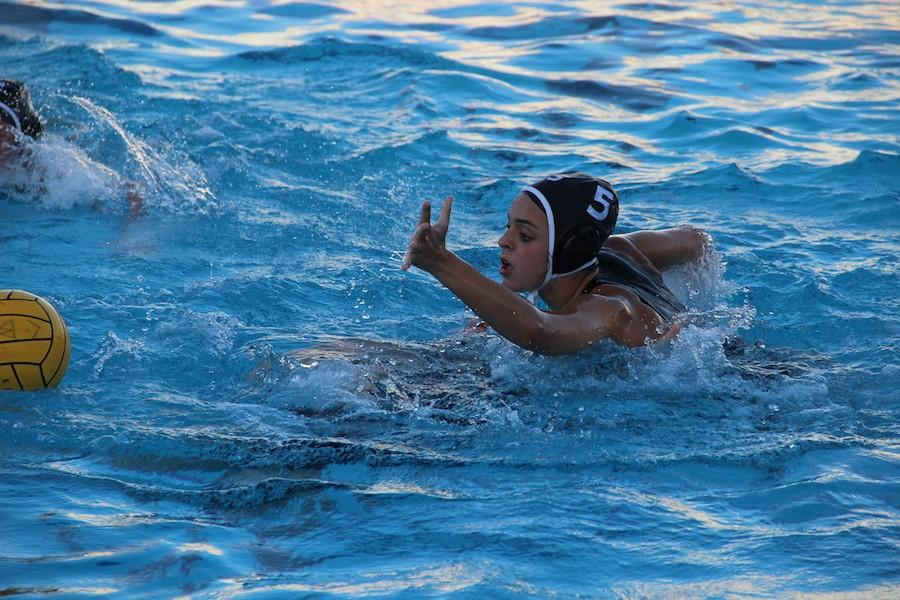 Amy Coval (#50) blocks a pass at their game on Wed. Feb 10. They played La Jolla and lost 8-11.