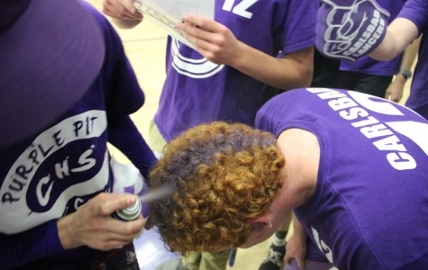 Loud Crowd leader Kyle Plotkin gets his hair dyed mid game last week against Sage Creek. Many other fans showed their purple pride helping the Lancers win 54-49.