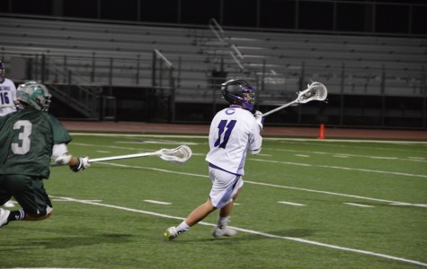 Senior, Ty Funderburk, turns to pass the ball to his teammate for a chance to score. The Lancers fall short against Poway on Fri, Mar. 4, the score coming to 5-14, Poway.