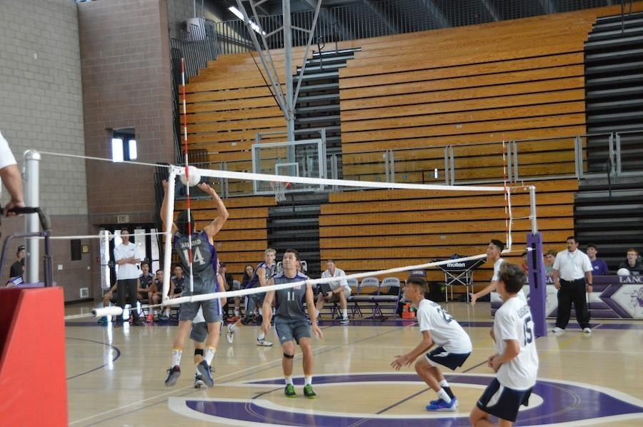 Senior, Jake Stevens, sets it towards senior, Troy Cassidy, for a hit against Kamehameha, a team from Hawaii. The varsity boy's volleyball team played on Tues. Mar. 15, winning 3-1.