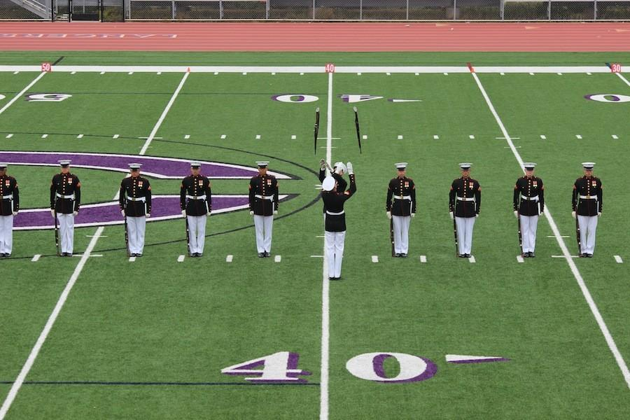 The Silent Drill Platoon demonstrates ticks with their guns and impresses the crowd.