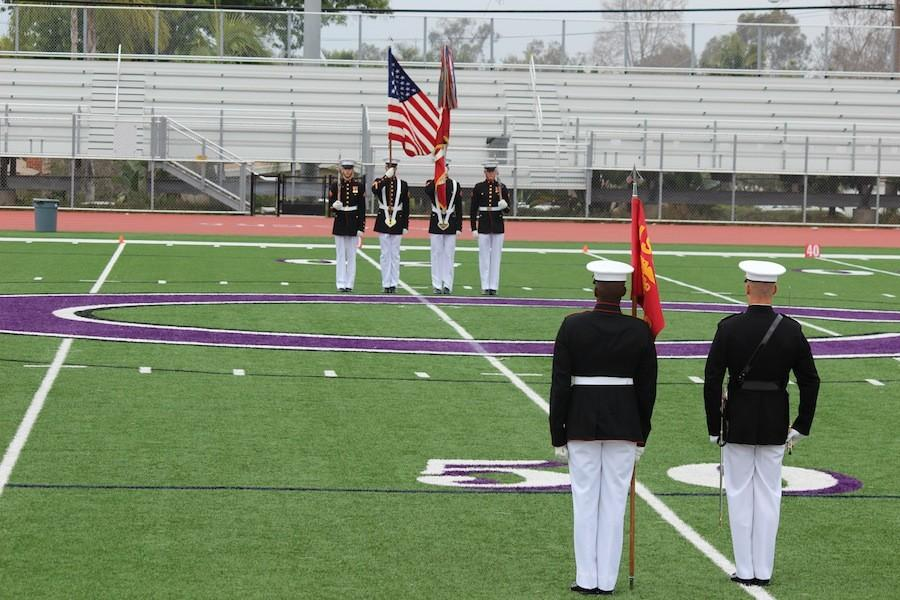 The Silent Drill Platoon line up with their flags as part to end the Battle Color  Ceremony.