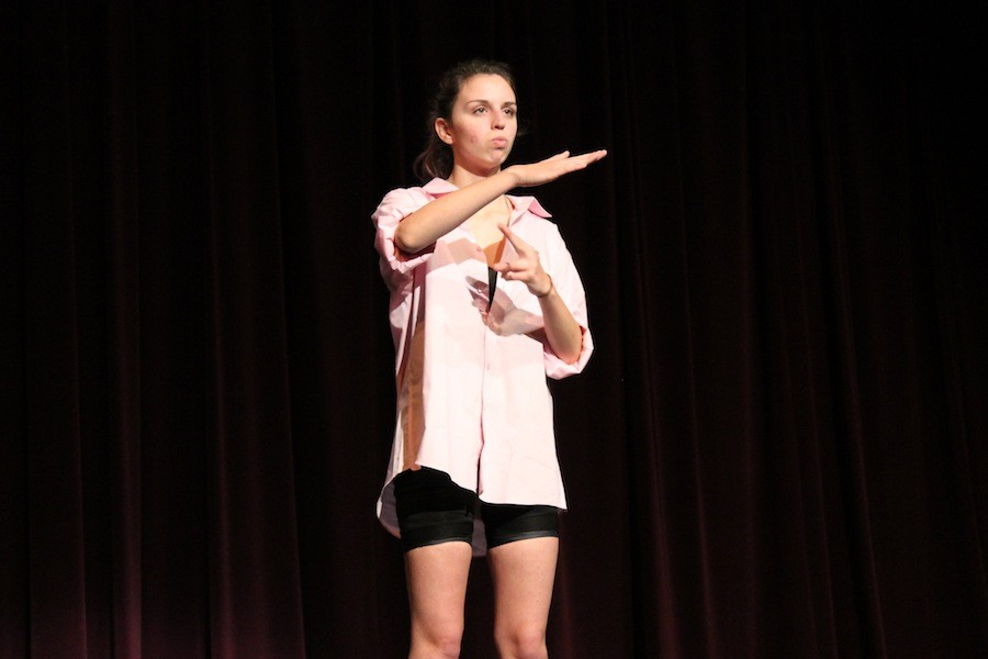 Every year ASL has a fall and spring performance. This years theme was decades. Anna Cunningham practices her part in the show.