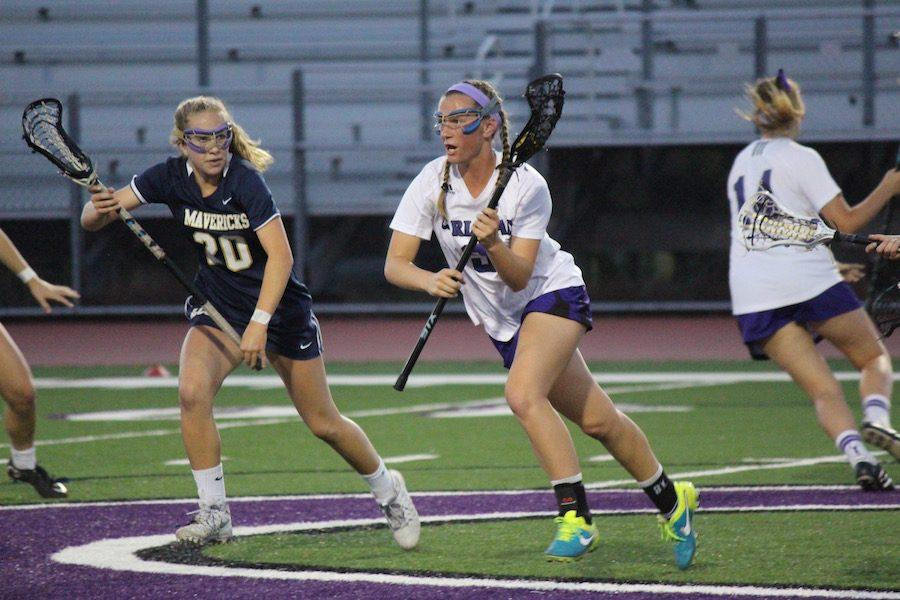 After gaining possession of the draw, Delaney Benson (12) rushes down the field,putting the Lancers on offense.  Tues. Apr. 9 Carlsbad's varsity women lacrosse went head to head against their local rival, LCC. The final score was 2-12 Mavericks.