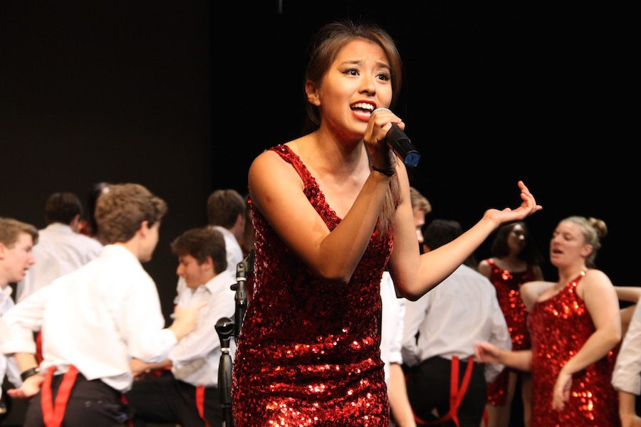 Megan Chua (12) sings during Sound Express' final act.