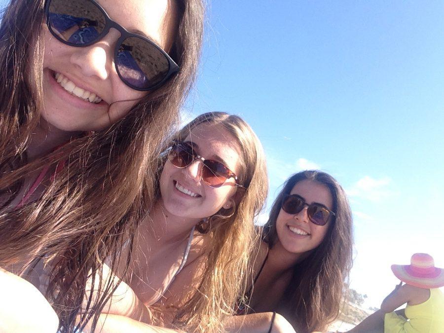 Seniors Ashley Lang, Olivia Easterbrook, and Kallan Arkeder enjoy the beginning of summer at the beach.