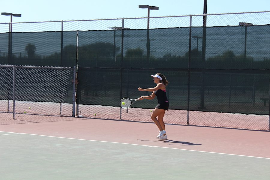 Senior, Audrey Oas warms up passing back and forth with Senior Alexis Mertz. Wed. Aug. 31 the Carlsbads womens tennis team played Sage Creek in their second match of the season.