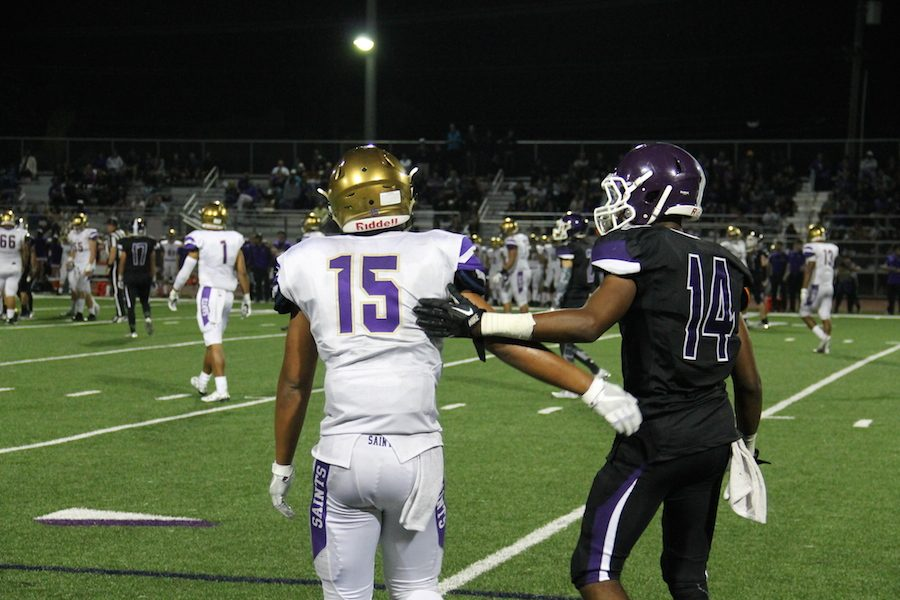 Senior Jeremy Cooper shows good sportsmanship as he helps up a player of the opposing team after a tackle. Fri. Sept. 2 Carlsbad High School's varsity football played Saint Augustine for their first home game of the season. The final score was 28-7 Saints.