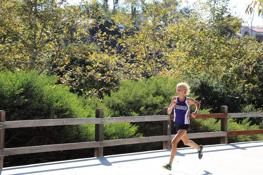 Sophomore%2C+Hannah+Hartwell%2C+gains+distance+on+her+other+competitors.%0ASept.+13%2C+cross+country++competed+in+the+team%27s+second+meet+of+the+season+at+Poinsettia+Park.