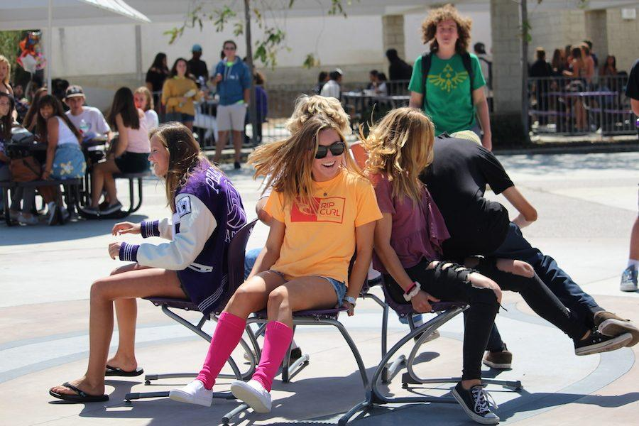 CHS+students+participate+in+a+game+of+musical+chairs+with+hopes+to+win+and+take+home+a+neon+loud+crowd+shirt.+Fri.+Sept.+23+Carlsbad+had+their+second+pep+rally+of+the+year+with+multiple+games+and+prizes+for+students+to+participate+in+and+take+home.