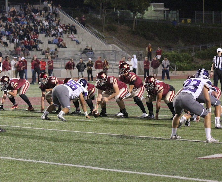 Carlsbad defense prepares to rush a snap against Mission Hills High School's offense. On Fri., Sept. 16 after a close game Carlsbad lost 12-7.