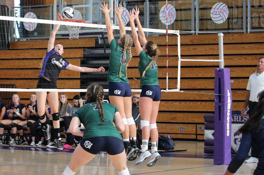 Freshman Mackenzie Karnig spikes the ball expanding the teams lead. On Tuesday Sep 14, the varsity girls volleyball team played the Del Norte Nighthawks.