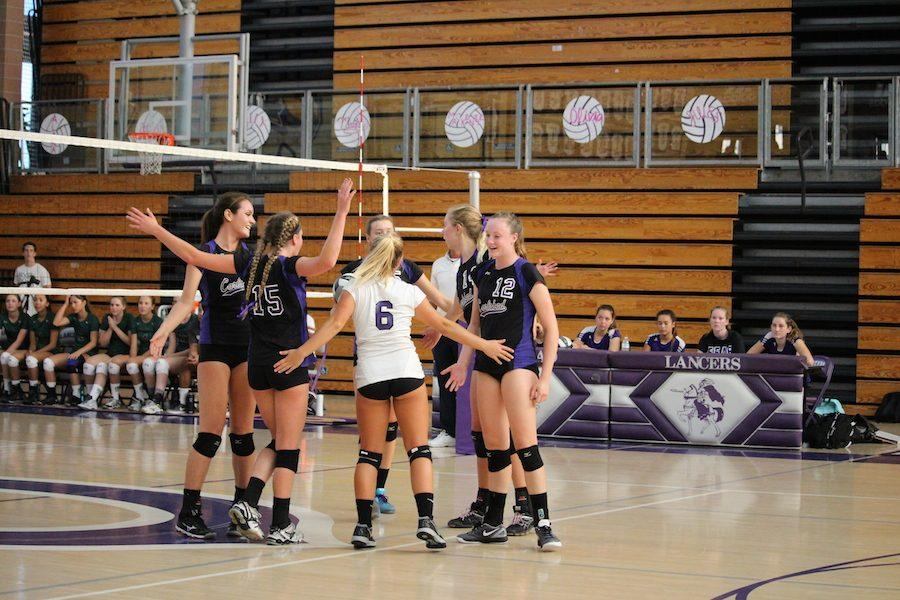 The girls varsity volleyball team plays in the Lancer Arena on Thursday, Sep 14. The girls celebrate after gaining a point and expanding their lead. After playing a tough game, the team ended up losing to the Del Norte Nighthawks.