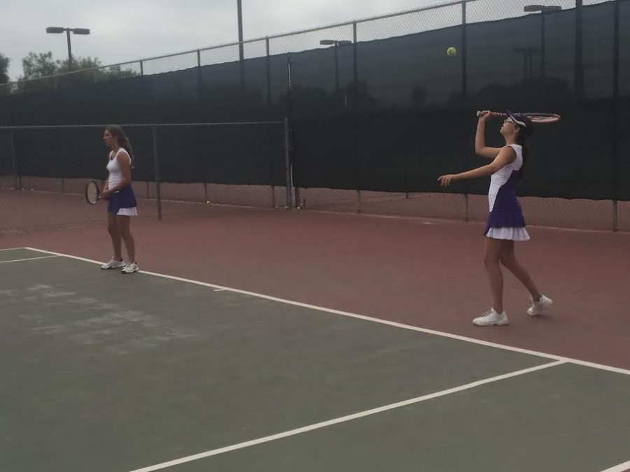 Freshman, Kelly Picton practices her serve before a match. Thurs. Sept. 15 Carlsbads junior varsity girls tennis team played against San Dieguito Academy at home.