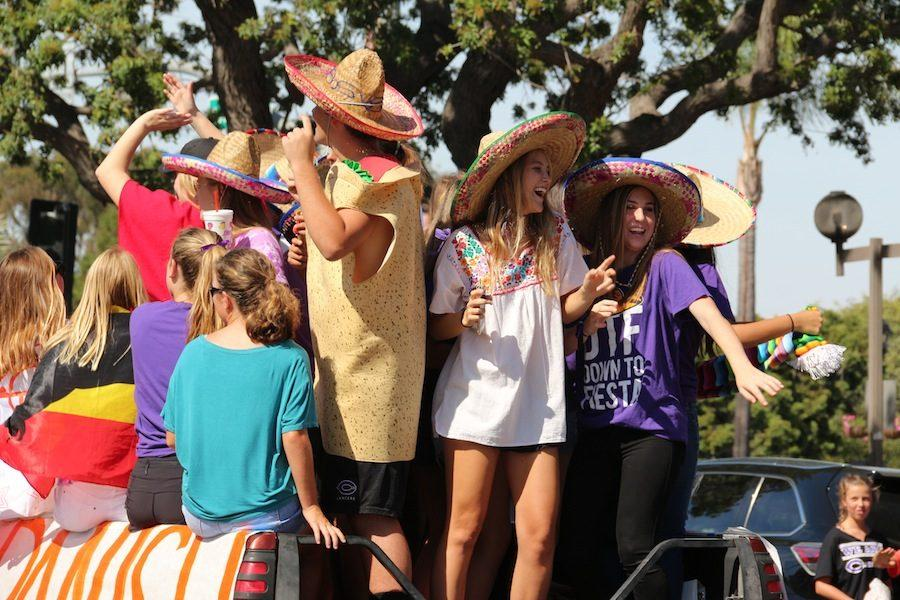 CHS+sophomores%2C+Grayson+Emery+and+Nina+Accardi%2C+dance+on+the+Spanish+Club+truck+as+it+drives+in+downtown+Carlsbad.+Last+Friday%2C+Oct.+7%2C+members+of+the+Carlsbad+community+marched+in+the+parade+as+part+of+homecoming+week.+