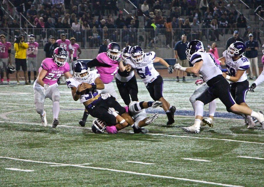 Senior Jesse Atiga gets tackled to the ground as he fights his way through San Marcos' defense. On Friday, October 14th, the Lancers took on the Knights for Carlsbad's white out game. The Lancer's fought hard but ended up losing 21-16.