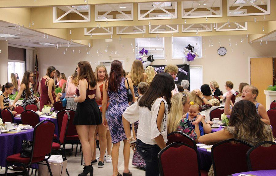 Members of Xcalibur and their family gather around before heading outside after the festivities. Sat. Oct. 15 Carlsbads JV Xcalibur dance team hosted their annual mother daughter tea party at the Carlsbad Senior Center. The day was filled with many activities including a tea party, a fashion show, and much more.