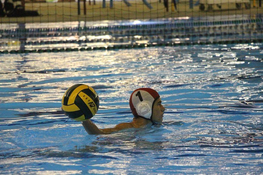 JV goalie, Max Ward (11)  passes the ball to a teammate after saving a goal. Wed. Oct. 19 Carlsbad High Schools mens water polo went head to head at LCC against Mavericks.