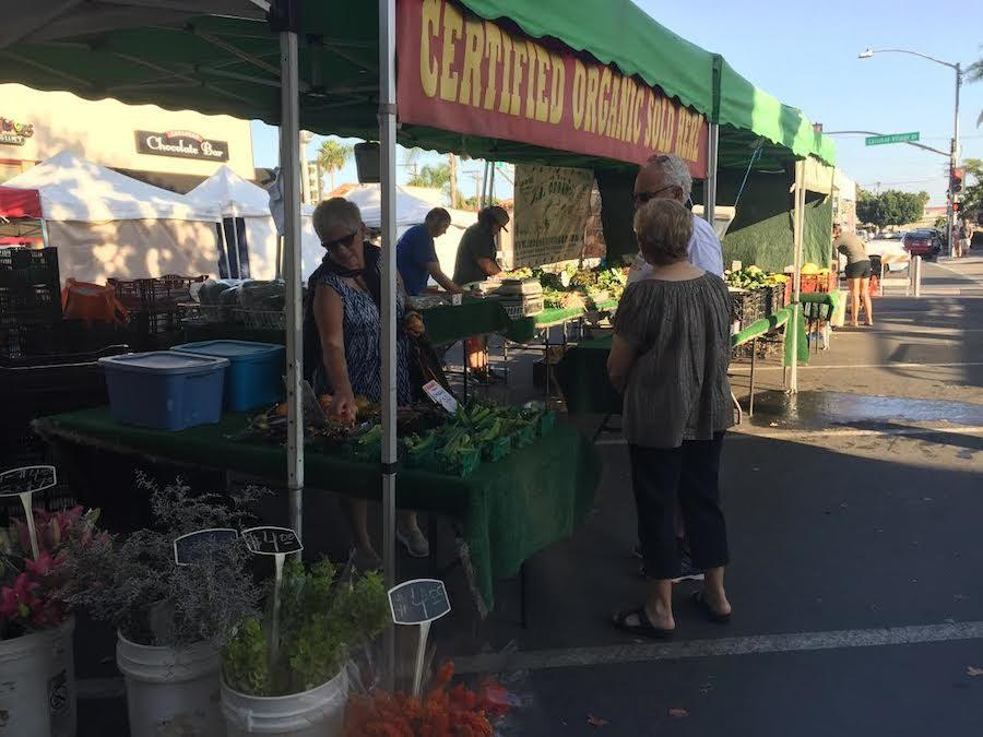 Members of the Carlsbad community come together to buy local goods at the weekly Carlsbad Street Fair. Wed. Oct. 5 Carlsbad hosted their weekly street fair on State St. in the village. Many local businesses come together to sell a variety of goods to members of the town.
