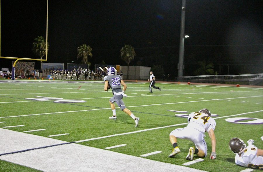 Junior Asa Turner runs towards the touchdown. On Friday Oct. 28th the Carlsbad Lancers played the El Camino for their last game of the season. Turner ended up scoring a touchdown and increasing their lead 37-28.