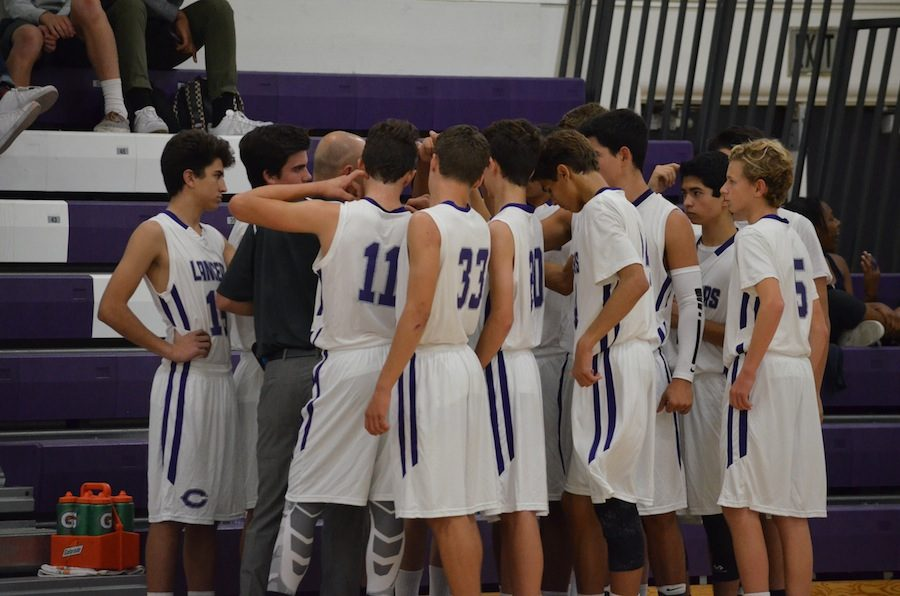 On Dec. 7th the Freshman basketball team played against Mount Carmel. Head coach, Lucas Porter, huddled the boys around after number five makes both of his free shots, bringing them into the lead 23-16.