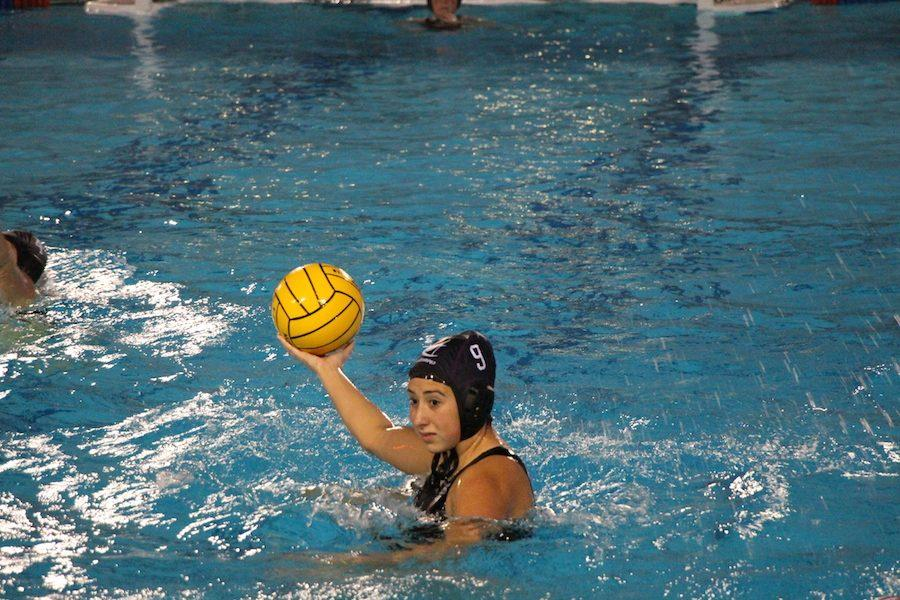 Freshman, Laurene Padilla passes the ball to a teammate to assist a goal. Thurs. Dec. 8 Carlsbad Highs  girls water polo team played Torrey Pines, coming out with w win, 20-3.