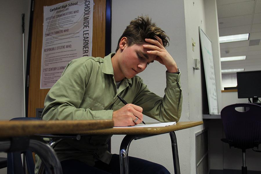 Junior Nick Beith stresses to finish his English 4 AP test,  due to strain from his multiple extracurriculars.