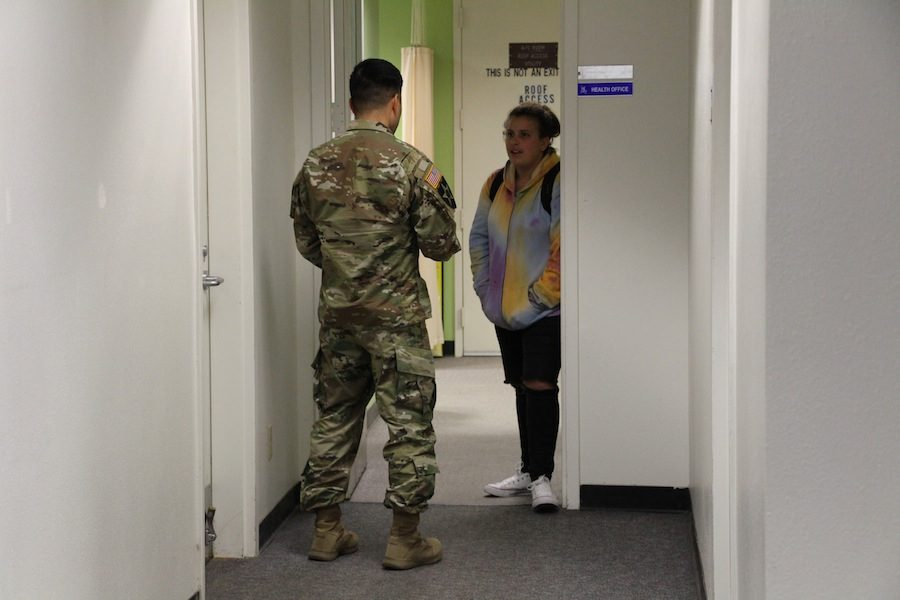 A member of the U.S Army speaks to a CHS student in the Guidance Office. Last Wednesday, January  18, members of the U.S Army visited Carlsbad to converse with any students who have any questions or concerns about the Army.