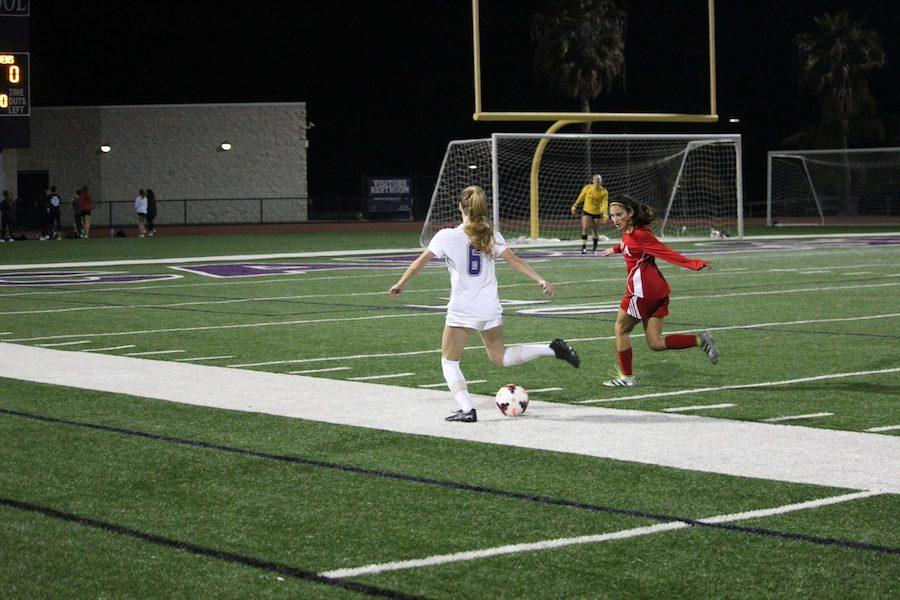 Senior, Julia Taliana rushes down the field to beat her defender. On Thurday, Febuary 2nd the Lancers took on the Ravens in a heated battle. Carlsbad ended up winning 2-0 to CCA.